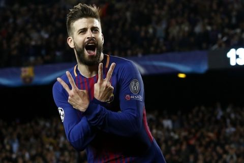 Barcelona's Gerard Pique celebrates after scoring the third goal of his team during a Champions League quarter-final, first leg soccer match between FC Barcelona and Roma at the Camp Nou stadium in Barcelona, Spain, Wednesday, April 4, 2018.(AP Photo/ Manu Fernandez)