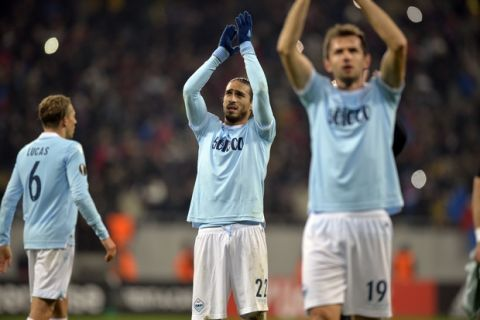 Lazio'sMartin Caceres, aplaud fans after a round of 32, first leg, Europa League soccer match between Steaua Bucharest and Lazio on the National Arena, in Bucharest, Romania, Thursday, Feb. 15, 2018.(AP Photo/Raed Krishan)