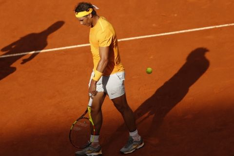 Rafael Nadal from Spain walks along the court during a Madrid Open tennis tournament match with Dominic Thiem from Austria in Madrid, Spain, Friday, May 11, 2018. Thiem won 7-5, 6-3. (AP Photo/Francisco Seco)