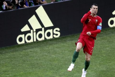 Portugal's Cristiano Ronaldo celebrates after scoring the opening goal by penalty during the group B match between Portugal and Spain at the 2018 soccer World Cup in the Fisht Stadium in Sochi, Russia, Friday, June 15, 2018. (AP Photo/Thanassis Stavrakis)
