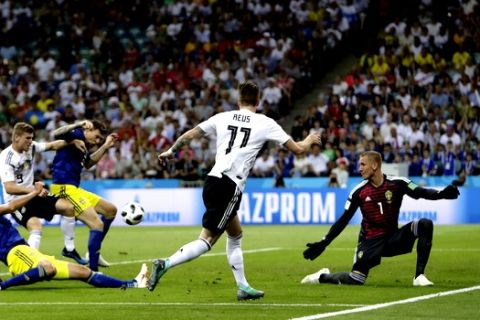 Germany's Marco Reus, center, plays a cross during the group F match between Germany and Sweden at the 2018 soccer World Cup in the Fisht Stadium in Sochi, Russia, Saturday, June 23, 2018. (AP Photo/Michael Probst)
