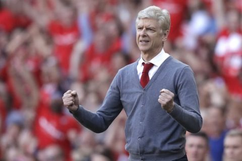 Arsenal's French manager Arsene Wenger celebrates his side's second goal during the English Premier League soccer match between Arsenal and Burnley at the Emirates Stadium in London, Sunday, May 6, 2018. The match is Arsenal manager Arsene Wenger's last home game in charge after announcing in April he will stand down as Arsenal coach at the end of the season after nearly 22 years at the helm. (AP Photo/Matt Dunham)