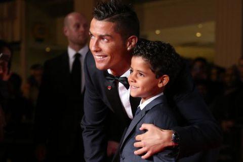 Cristiano Ronaldo, left, and his son Cristiano Ronaldo Junior  pose for photographers upon arrival at the world premiere of the film 'Ronaldo, in London, Monday, Nov. 9, 2015. (Photo by Joel Ryan/Invision/AP)