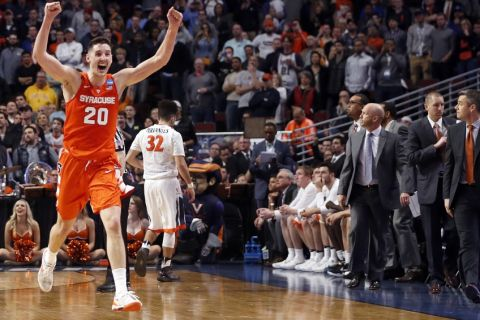 Syracuse's Tyler Lydon (20) celebrates after a college basketball game against Virginia in the regional finals of the NCAA Tournament, Sunday, March 27, 2016, in Chicago. (AP Photo/Charles Rex Arbogast)