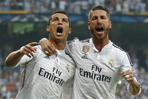 Real Madrid's Cristiano Ronaldo and teammate Sergio Ramos, right, celebrate after Ronaldo scored 1-0 during the Champions League second leg semifinal soccer match between Real Madrid and Juventus, at the Santiago Bernabeu stadium in Madrid, Wednesday, May 13, 2015. (AP Photo/Daniel Ochoa de Olza)