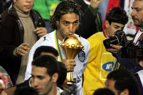 Egypt's Mido kisses the cup after Egypt won the African Nations Cup final soccer match between Egypt and Ivory Coast at the Cairo International Stadium in Egypt Friday, Feb. 10, 2006. Final score was a 4-2 penalty win for Egypt after a 0-0 draw. (AP Photo/Ben Curtis)