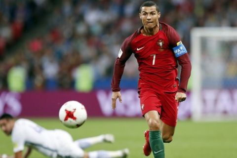 FILE - In this Wednesday, June 28, 2017 filer, Portugal's Cristiano Ronaldo keeps his eyes on the ball during the Confederations Cup, semifinal soccer match between Portugal and Chile, at the Kazan Arena, Russia. (AP Photo/Pavel Golovkin, File)