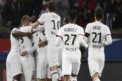 Rennes players celebrate scoring their side's first goal during their League One soccer match between Paris Saint-Germain and Stade Rennais at the Parc des Princes stadium in Paris, Saturday May 12, 2018. (AP Photo/Christophe Ena)