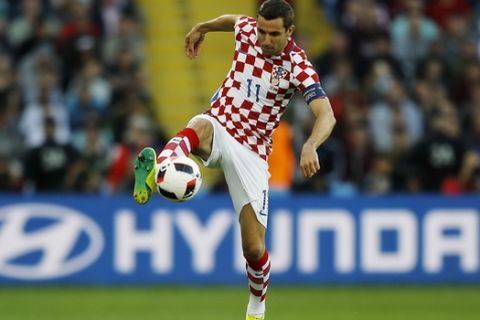 Croatia's Darijo Srna goes for the ball during the Euro 2016 round of 16 soccer match between Croatia and Portugal at the Bollaert stadium in Lens, France, Saturday, June 25, 2016. (AP Photo/Frank Augstein)