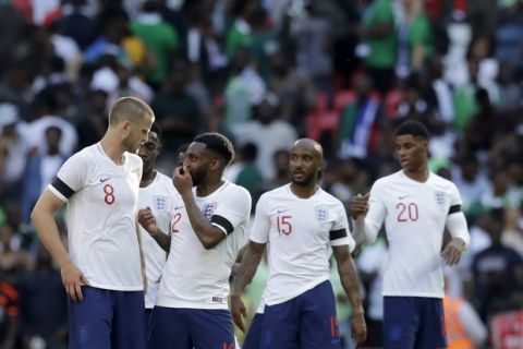 England's Eric Dier, left, speaks with Danny Rose at the end of the friendly soccer match between England and Nigeria at Wembley stadium in London, Saturday, June 2, 2018. (AP Photo/Matt Dunham)