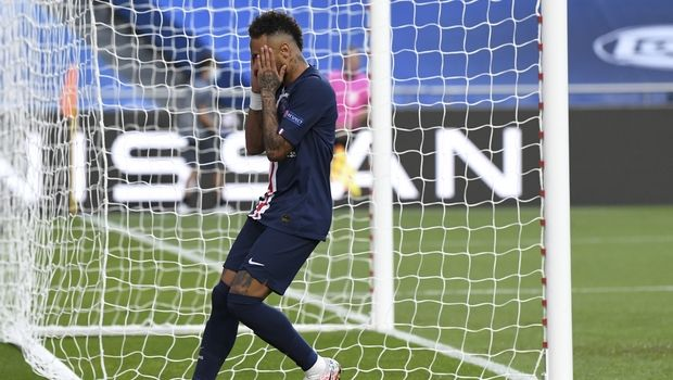 PSG's Neymar reacts after missing an opportunity to score during the Champions League semifinal soccer match between RB Leipzig and Paris Saint-Germain at the Luz stadium in Lisbon, Portugal, Tuesday, Aug. 18, 2020. (David Ramos/Pool Photo via AP)