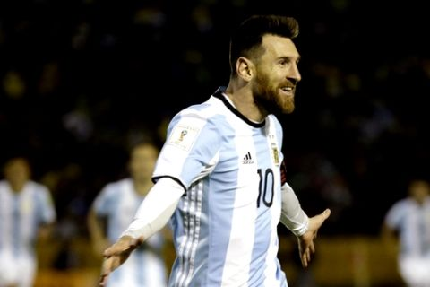 In this Tuesday, Oct. 10, 2017 photo, Argentina's Lionel Messi celebrates after scoring his third goal against Ecuador during their 2018 World Cup qualifying soccer match at the Atahualpa Olympic Stadium in Quito, Ecuador. Messis three goals lifted Argentina into the World Cup on the last day of South American qualifying, keeping the Argentines from missing out for the first time since 1970. (AP Photo/Fernando Vergara)