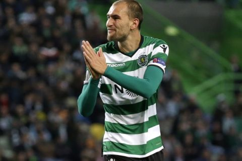 Sporting's Bas Dost gestures during the Europa League round of 32 second leg soccer match between Sporting CP and Astana at the Alvalade stadium in Lisbon, Thursday Feb. 22, 2018. (AP Photo/Armando Franca)