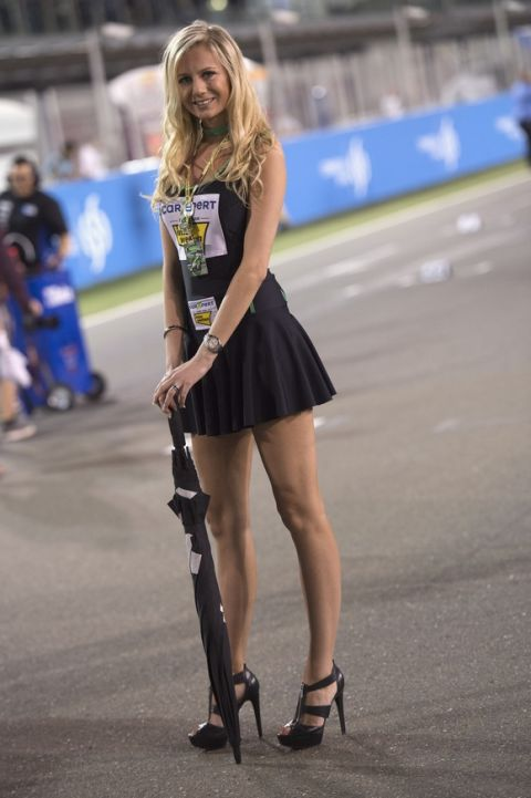 DOHA, QATAR - MARCH 20: A grid girl poses on track during the Moto2 race during the MotoGp of Qatar - Race at Losail Circuit on March 20, 2016 in Doha, Qatar. (Photo by Mirco Lazzari gp/Getty Images)