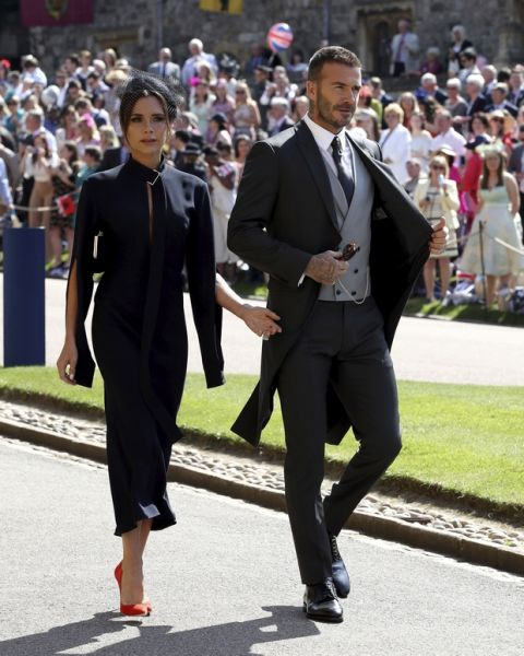 David and Victoria Beckham arrive for the wedding ceremony of Prince Harry and Meghan Markle at St. George's Chapel in Windsor Castle in Windsor, near London, England, Saturday, May 19, 2018. (Chris Radburn/pool photo via AP)