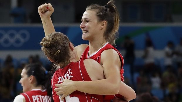 Serbia's Danielle Page (15) holds teammate Serbia's Nevena Jovanovic as they celebrate their women's bronze medal basketball game win over France at the 2016 Summer Olympics in Rio de Janeiro, Brazil, Saturday, Aug. 20, 2016. (AP Photo/Eric Gay)