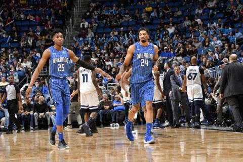 ORLANDO, FL - JANUARY 16: Wesley Iwundu #25 and Khem Birch #24 of the Orlando Magic react during game against the Minnesota Timberwolves on January 16, 2018 at Amway Center in Orlando, Florida. NOTE TO USER: User expressly acknowledges and agrees that, by downloading and or using this photograph, User is consenting to the terms and conditions of the Getty Images License Agreement. Mandatory Copyright Notice: Copyright 2018 NBAE (Photo by Fernando Medina/NBAE via Getty Images)