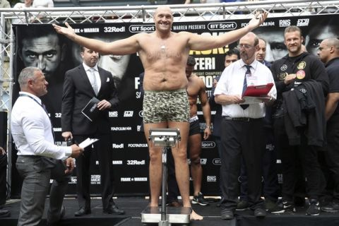 Britain boxer Tyson Fury takes part in a weigh-in, at The Great Northern, in Manchester, England, Friday June 8, 2018, ahead of the heavyweight bout against Macedonia born, Swiss boxer Sefer Seferi on Saturday.  (Nick Potts/PA via AP)