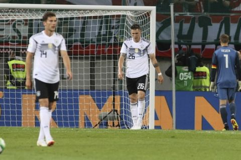 Germany's Leon Goretzka, Niklas Suele and goalkeeper Manuel Neuer, from left to right, react after Austria scored their second goal during a friendly soccer match between Austria and Germany in Klagenfurt, Austria, Saturday, June 2, 2018. (AP Photo/Ronald Zak)