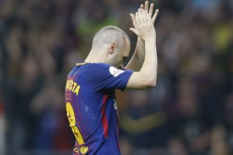 Barcelona's Andres Iniesta leave the pitch during the Copa del Rey final soccer match between Barcelona and Sevilla at the Wanda Metropolitano stadium in Madrid, Spain, Saturday, April 21, 2018. (AP Photo/Francisco Seco)