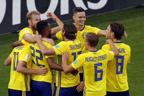 Sweden players celebrate after Mexico's Edson Alvarez scores an own goal during the group F match between Mexico and Sweden, at the 2018 soccer World Cup in the Yekaterinburg Arena in Yekaterinburg , Russia, Wednesday, June 27, 2018. (AP Photo/Efrem Lukatsky)