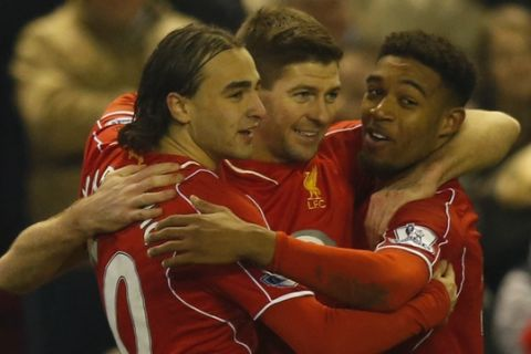 Liverpool's Steven Gerrard, center, celebrates scoring with teammates Lazar Markovic, left, and Jordon Ibe during the English Premier League soccer match between Liverpool and Tottenham Hotspur at Anfield Stadium, Liverpool, England, Tuesday Feb. 10, 2015. (AP Photo/Jon Super)