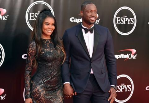 NBA basketball player Dwyane Wade, right, and Gabrielle Union arrive at the ESPY Awards at the Microsoft Theater on Wednesday, July 13, 2016, in Los Angeles. (Photo by Jordan Strauss/Invision/AP)