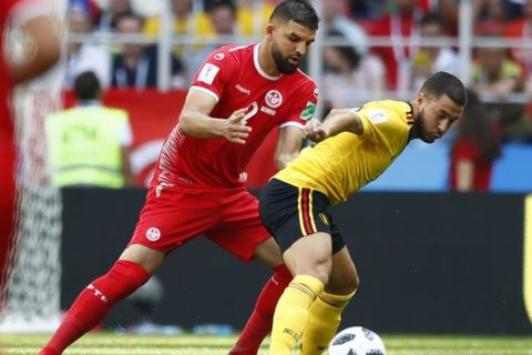 Tunisia's Syam Ben Youssef, left, and Belgium's Eden Hazard challenge for the ball during the group G match between Belgium and Tunisia at the 2018 soccer World Cup in the Spartak Stadium in Moscow, Russia, Saturday, June 23, 2018. (AP Photo/Matthias Schrader)