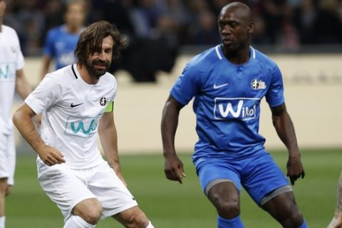 Andrea Pirlo controls the ball next to Clarence Seedorf, during Andrea Pirlo farewell exhibition match, at the Milan San Siro Stadium, Italy, Monday, May 21, 2018. (AP Photo/Antonio Calanni)