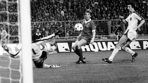 FILE - In this May 11, 1978 file photo, Kenny Dalglish of Liverpool, dark shirt, centre, scores the only goal of the match against Bruges during the European Cup Final at Wembley Stadium, London. On Saturday, June 3,  2017 the Millennium Stadium in Cardiff, Wales will become the fourth British ground to host the final when Real Madrid meets Juventus. (AP Photo, File)