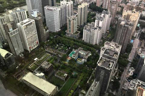 U.S. consulate buildings, center bottom, are surrounded by high-rise buildings in Guangzhou in south China's Guangdong province, Thursday, June 7, 2018. A U.S. medical team was screening more Americans who work in a southern Chinese city as the State Department confirmed evacuating a number of government workers who experienced unexplained health issues like those that have hurt U.S. personnel in Cuba and China. (Color China Photo via AP)