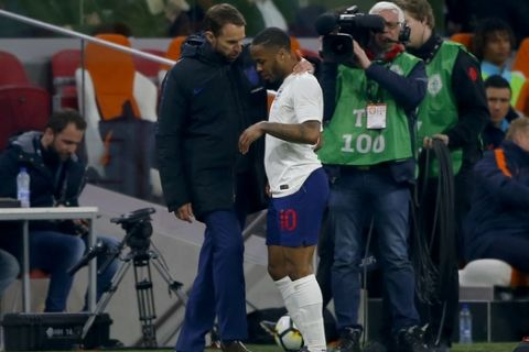 England's head coach Gareth Southgate speaks with Raheem Sterling after he was substituted during the international friendly soccer match between the Netherlands and England at the Amsterdam ArenA in Amsterdam, Netherlands, Friday, March 23, 2018. (AP Photo/Peter Dejong)