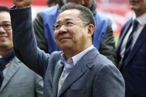 In a Jan. 5, 2016 photo, Leicester City Chairman Vichai Srivaddhanaprabha gestures to the crows at a soccer game in  Manchester, England. English soccer club Leicester City says owner Vichai Srivaddhanaprabha is among five people who died in helicopter crash following a soccer game Saturday evening, Oct. 27, 2017. (Martin Rickett/PA via AP)