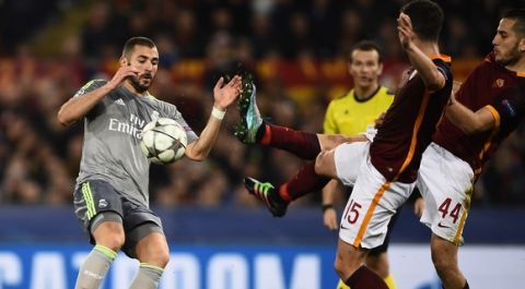 Real Madrid's French forward Karim Benzema vies with Roma's midfielder from Bosnia-Herzegovina Miralem Pjanic and Roma's defender from Greece Konstas Manolas (R) during the UEFA Champions League football match AS Roma vs Real Madrid on Frebruary 17, 2016 at the Olympic stadium in Rome.   AFP PHOTO / FILIPPO MONTEFORTE / AFP / FILIPPO MONTEFORTE        (Photo credit should read FILIPPO MONTEFORTE/AFP/Getty Images)