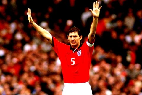 England's Tony Adams gestures during the group 9 World Cup Championship 2002 qualification match England versus Germany at the London Wembley stadium, Saturday Oct. 7, 2000. The match is the last one ever played at the famous Wembley stadium which will be teared down and replaced by a modern designed arena. (AP Photo/Christof Stache)