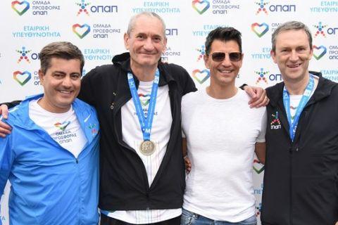 Η «Ομάδα Προσφοράς ΟΠΑΠ» έκοψε πρώτη το νήμα στον 37ο  Μαραθώνιο της Αθήνας