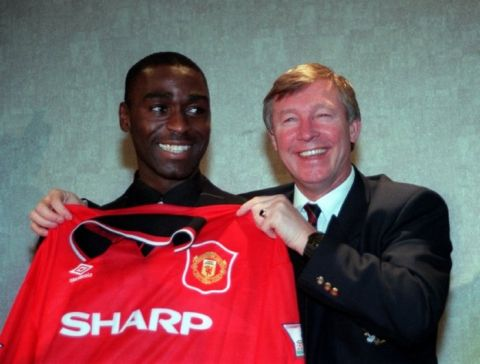 Manchester United's  6 million new signing from Newcastle United  Andy Cole (left), pictured at their Old Trafford ground, in Manchester, with the team's manager Alex Ferguson.