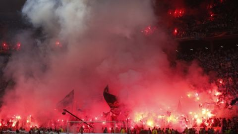 Soccer fans burn flares before the Europa League Final soccer match between Marseille and Atletico Madrid at the Stade de Lyon outside Lyon, France, Wednesday, May 16, 2018. (AP Photo/Thibault Camus)