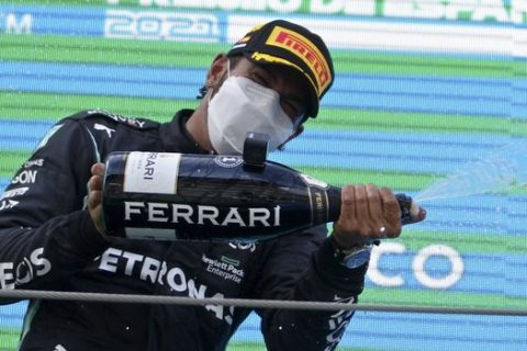 Mercedes driver Lewis Hamilton of Britain celebrates on the podium after winning the Spanish Formula One Grand Prix at the Barcelona Catalunya racetrack in Montmelo, just outside Barcelona, Spain, Sunday, May 9, 2021. (AP Photo/Emilio Morenatti, Pool)