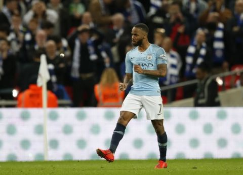 Manchester City's Raheem Sterling celebrates after scoring the winning penalty during the English League Cup final soccer match between Chelsea and Manchester City at Wembley stadium in London, England, Sunday, Feb. 24, 2019. (AP Photo/Alastair Grant)