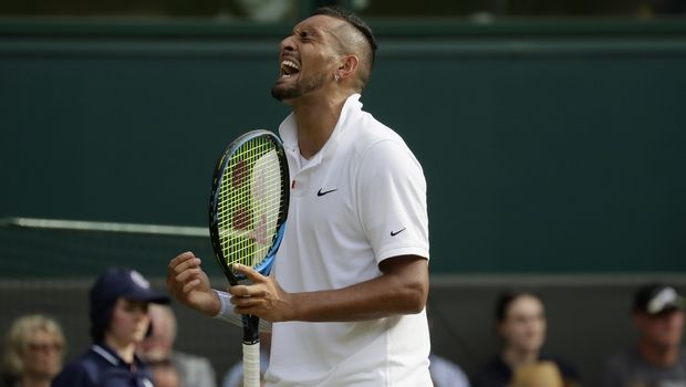 Australia's Nick Kyrgios reacts after winning a point against Spain's Rafael Nadal in a Men's singles match during day four of the Wimbledon Tennis Championships in London, Thursday, July 4, 2019. (AP Photo/Kirsty Wigglesworth)