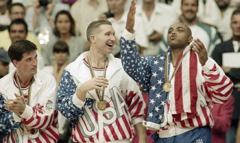 FILE - In this Aug. 8, 1992, file photo, From left the USA's John Stockton, Chris Mullin, and Charles Barkley rejoice with their gold medals after beating Croatia 117-85 in the gold medal game in men's basketball at the Summer Olympics in Barcelona. It's not an urban legend: The Dream Team really did lose a scrimmage to a group of college stars as the future Hall of Famers prepared for the 1992 Olympics. Footage of that game is among the new behind-the-scenes material in the 20-year anniversary documentary that premieres on NBA TV on Wednesday. (AP Photo/John Gaps III, File)