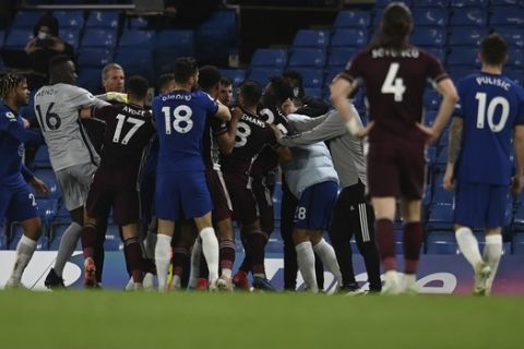 Leicester City and Chelsea players clash during the English Premier League soccer match between Chelsea and Leicester City at Stamford Bridge Stadium in London, Tuesday, May 18, 2021. (Glyn Kirk/Poolvia AP)
