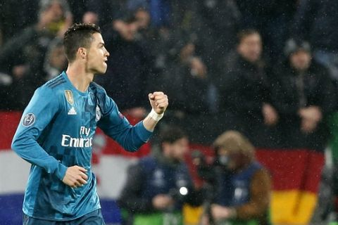 Real Madrid's Cristiano Ronaldo celebrates after scoring his side's opening goal during the Champions League first leg quarter final soccer match between Juventus and Real Madrid, at Juventus Stadium in Turin, Italy, Tuesday, April 3, 2018. (AP Photo/Antonio Calanni)