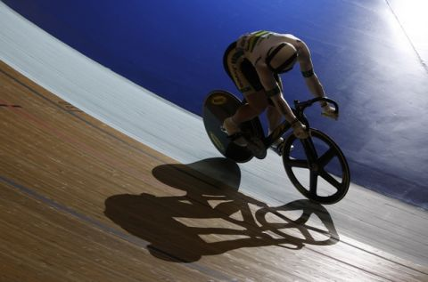 Australia's Shane Perkins casts a shadow on the track as he progresses to the semifinals with a win over USC team's Michael D'Almeida during the Men's Sprint at the Track Cycling World Cup Classics event at the Manchester Velodrome, Manchester, England, Saturday, Oct. 31, 2009. (AP Photo/Jon Super)