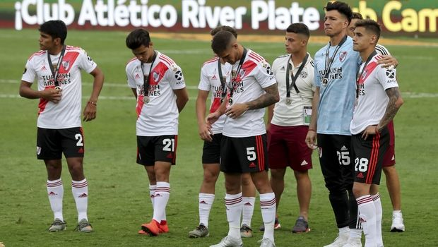 Players of Argentina's River Plate stand on the field after losing 1-2 against Brazil's Flamengo the Copa Libertadores final soccer match at the Monumental stadium in Lima, Peru, Saturday, Nov. 23, 2019. (AP Photo/Fernando Vergara)