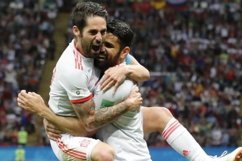 Spain's Diego Costa, right, celebrates with his teammate Isco after scoring his side's opening goal during the group B match between Iran and Spain at the 2018 soccer World Cup in the Kazan Arena in Kazan, Russia, Wednesday, June 20, 2018. (AP Photo/Frank Augstein)