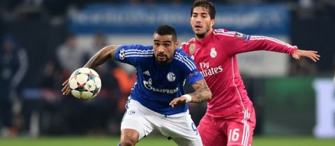 GELSENKIRCHEN, GERMANY - FEBRUARY 18:  Kevin-Prince Boateng of Schalke is closed down by Lucas Silva of Real Madrid during the UEFA Champions League Round of 16 match between FC Schalke 04 and Real Madrid at the Veltins-Arena on February 18, 2015 in Gelsenkirchen, Germany.  (Photo by Dennis Grombkowski/Bongarts/Getty Images)