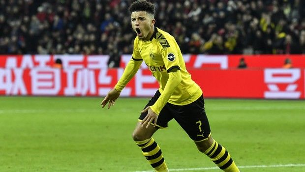 Dortmund's Jadon Sancho celebrates before his goal was cancelled during the German Bundesliga soccer match between Bayer Leverkusen and Borussia Dortmund in Leverkusen, Germany, Saturday, Feb. 8, 2020. Leverkusen defeated Dortmund with 4-3. (AP Photo/Martin Meissner)