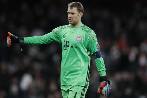 Bayern goalkeeper Manuel Neuer celebrates at the end of the Champions League round of 16 second leg soccer match between Arsenal and Bayern Munich at the Emirates Stadimum in London, Tuesday, March 7, 2017. Bayern won 5-1. (AP Photo/Kirsty Wigglesworth)